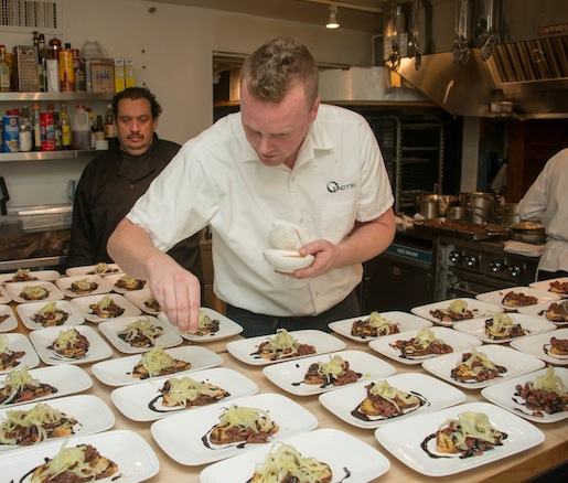 Chef Tyler Rodde plating squid in the Beard House kitchen